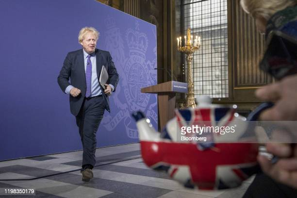Boris Johnson UK prime minister walks past a teapot featuring the design of a British Union flag also known as a Union Jack as he departs following a...