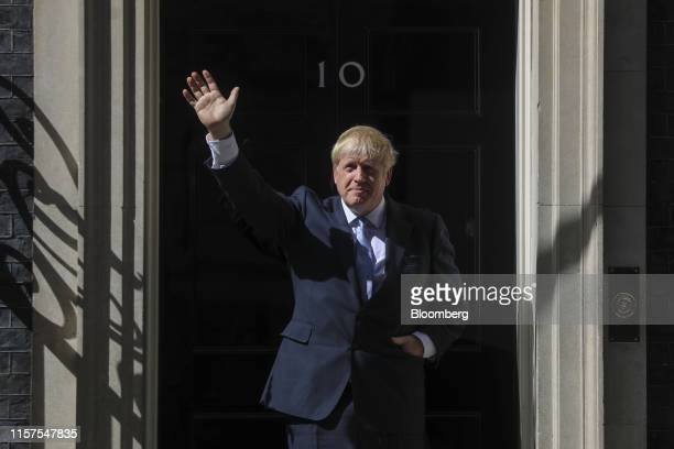 Boris Johnson UK prime minister waves as he enters number 10 Downing Street in London UK on Wednesday July 24 2019 British business is wasting no...