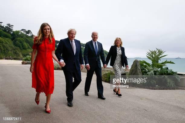 Boris Johnson, U.K. Prime minster, second left, and U.S. President Joe Biden, second right, walk U.S. First Lady Jill Biden, right, and Carrie...