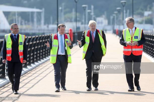 Boris Johnson walks with Charlie Elphicke UK lawmaker and Doug Bannister chief executive officer of Port of Dover Ltd during a visit to the Port of...