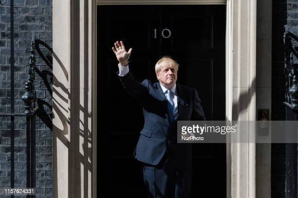 Boris Johnson waves as he enters 10 Downing Street for the first time as the new Prime Minister of the United Kingdom on 24 July 2019 in London...