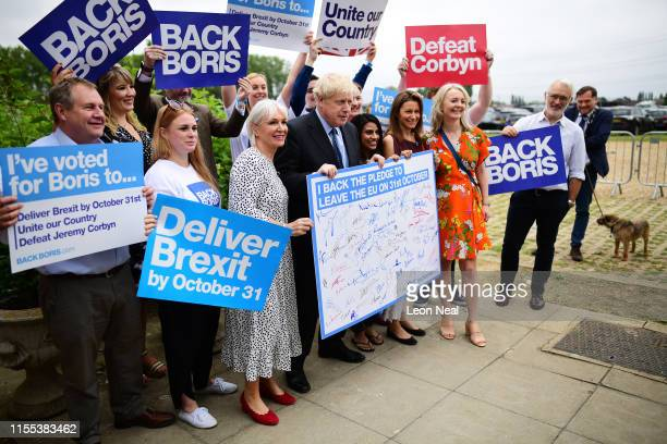 Boris Johnson with Conservative MP Nadine Dorries and supporters before the Conservative leadership hustings on July 13 2019 in Wyboston England...