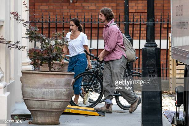 Boris Johnson's wife Marina Wheeler and son Milo assist as removal men take out belongings from the Foreign Secretary's graceandfavour residence in...