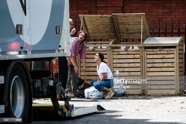 Boris Johnson's wife Marina Wheeler and son Milo take out rubbish as removal men remove belongings from the Foreign Secretary's graceandfavour...