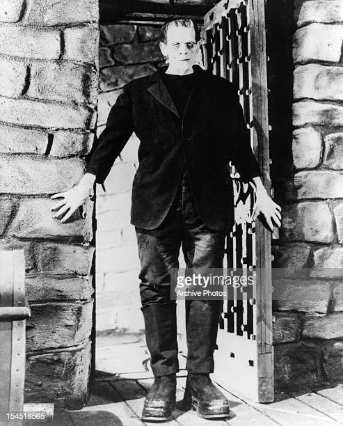 Boris Karloff as the monster entering doorway in a scene from the film 'Frankenstein' 1931