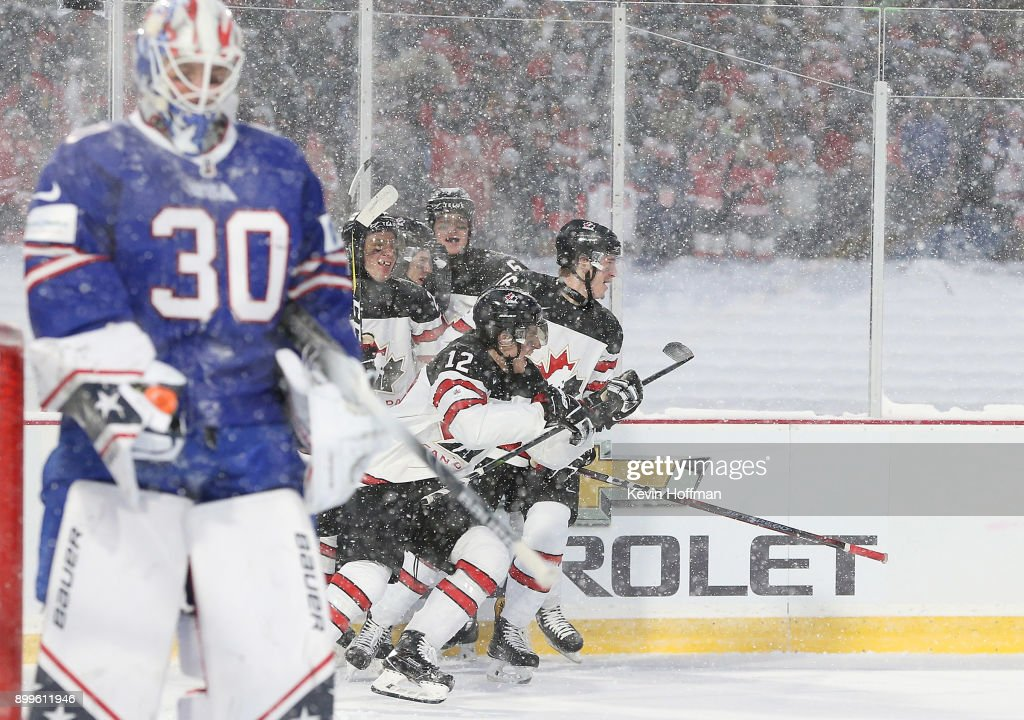Boris Katchouk #12 of Canada celebrates after scoring a goal on Jake Oettinger #30 of United States in the second period during the IIHF World Junior Championship at New Era Field on December 29, 2017 in Buffalo, New York.