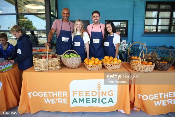 Boris Kodjoe Ali Larter Jonathan Bennet and Emily Tosta attend Celebrity Friends Of Feeding America volunteer at The Santa Monica Boys and Girls Club...