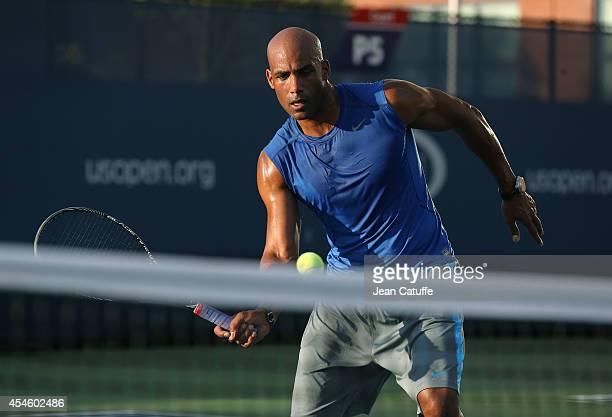 Boris Kodjoe plays tennis on the practice courts on Day 10 of the 2014 US Open at USTA Billie Jean King National Tennis Center on September 3, 2014...