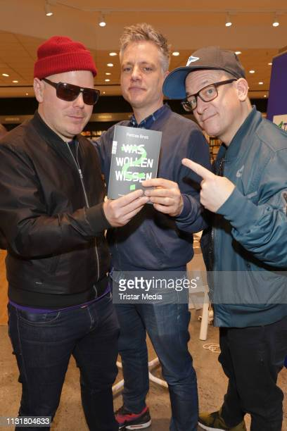 Boris Lauterbach Martin Vandreier and Bjoern Warns alias Fettes Brot during their autograph session to the book Was wolle wissen at Thalia on...