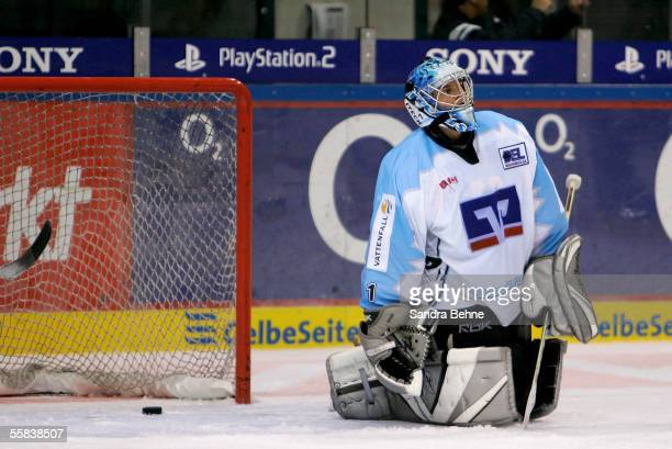 Boris Rousson of Freezers kneels on the ice after the fourth goal during the DEL match between ERC Ingolstadt and Hamburg Freezers at the Saturn...