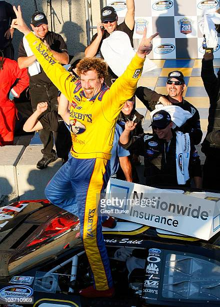 Boris Said, driver of the Zaxby's/PFC Ford, celebrates in victory lane after winning the NAPA Auto Parts 200 at Circuit Gilles-Villeneuve on August...