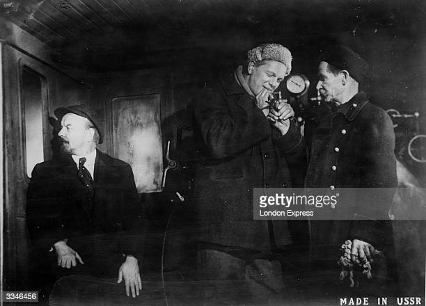 Boris Shchukin as the Russian revolutionary Vladimir Ilyich Lenin with a bodyguard and engine driver in the engine cabin of a train travelling from...