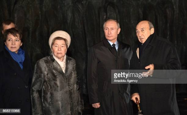 Boris Yeltsin's daughter Tatyana Yumasheva and his widow Naina Russia's President Vladimir Putin and sculptor Georgy Frangulyan attend the unveiling...