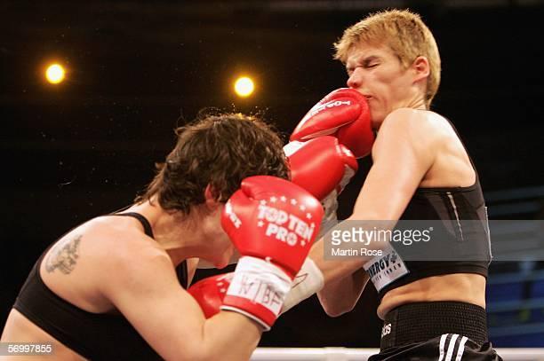 Borislava Goranova of Bulgaria hits Heidi Hartmann of Germany during the WIBF world championship junior middleweight fight between Heidi Hartmann of...
