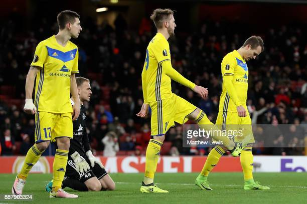 Borisov players react after conceding a goal during the UEFA Europa League group H match between Arsenal FC and BATE Borisov at Emirates Stadium on...