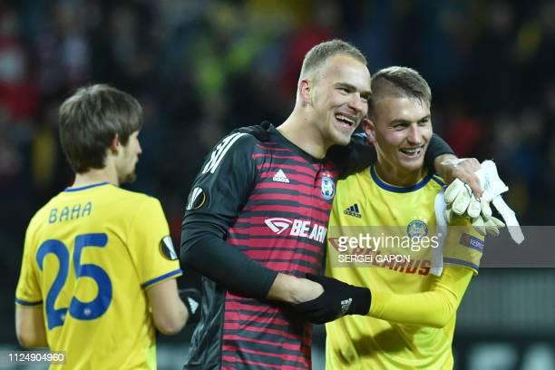 Borisov's Belarusian midfielder Dmitri Baha BATE Borisov's Belarus goalkeeper Denis Scherbitski and BATE Borisov's Belarusian defender Zakhar Volkov...