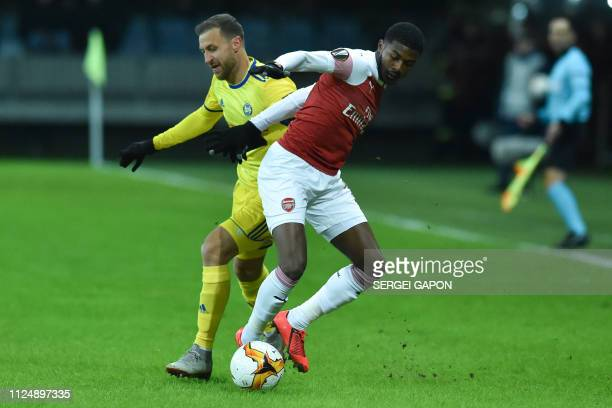 Borisov's Belarusian midfielder Ihor Stasevich and Arsenal's English midfielder Ainsley MaitlandNiles vie for the ball during the UEFA Europa League...