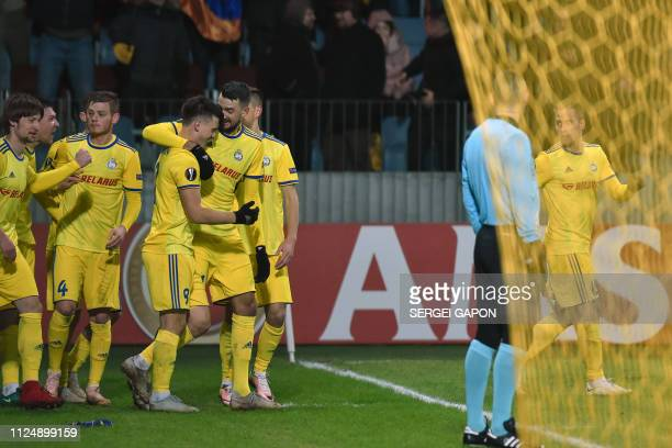Borisov's Belarusian midfielder Stanislav Dragun celebrates with teammates after scoring a goal during the UEFA Europa League round of 32 first leg...