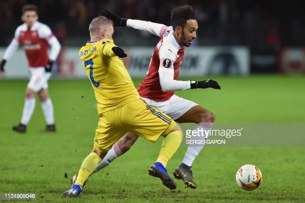 Borisov's Belarusian midfielder Yevgeniy Berezkin and Arsenal's Gabonese striker PierreEmerick Aubameyang vie for the ball during the UEFA Europa...