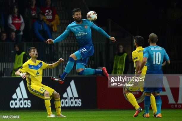 Borisov's defender from Belarus Aleksey Rios and Arsenal's forward from France Olivier Giroud vie for the ball during the UEFA Europa League Group H...