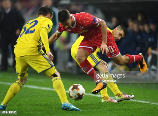 Borisov's forward from Belarus Mikhail Gordeichuk and Cologne's German midfielder Salih Ozcan vie for the ball during the UEFA Europa League football...