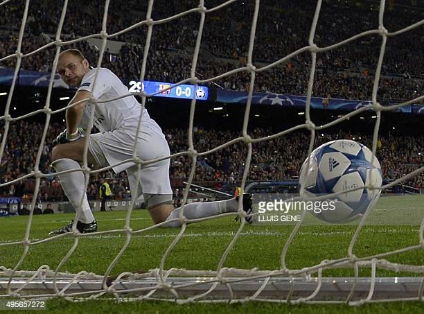 Borisov's goalkeeper Sergey Chernik looks the ball in his net after Barcelona's Brazilian forward Neymar scored during the UEFA Champions League...