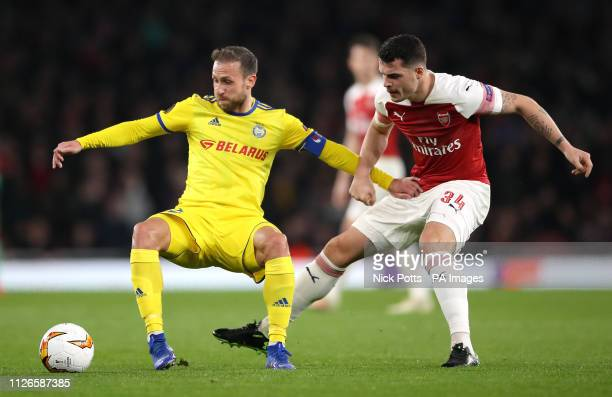 Borisov's Ihar Stasevich and Arsenal's Granit Xhaka battle for the ball during the UEFA Europa League round of 32 second leg match at the Emirates...