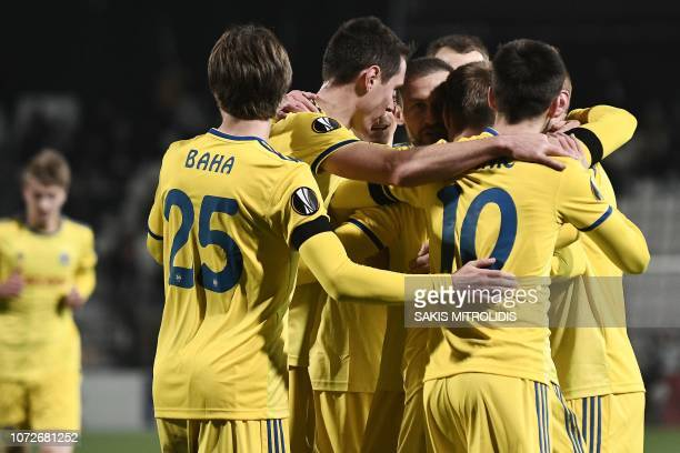 Borisov's players celebrate after scoring during the UEFA Europa League Group L football match between PAOK FC and FC BATE Borisov at the Toumba...