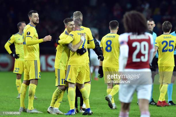 Borisov's players celebrate after the UEFA Europa League round of 32 first leg football match between FC BATE Borisov and Arsenal FC in Borisov...