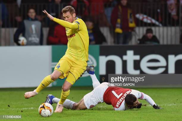 Borisov's Serbian defender Aleksandar Filipovic and Arsenal's Armenian midfielder Henrikh Mkhitaryan vie for the ball during the UEFA Europa League...