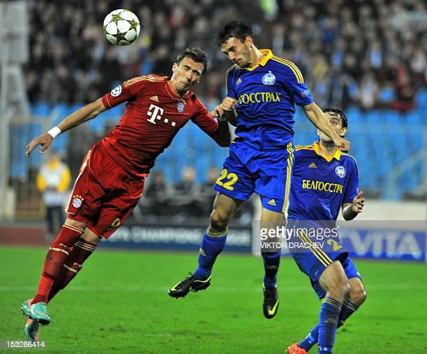 Borisov's Serbian defender Marko Simic fights for the ball against Bayern Munich's Croatian striker Mario Mandzukic during on their Champions League...