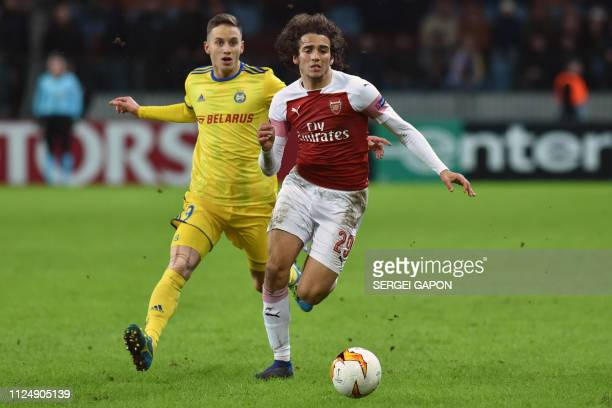 Borisov's Serbian forward Bojan Dubajic and Arsenal's French midfielder Matteo Guendouzi vie for the ball during the UEFA Europa League round of 32...