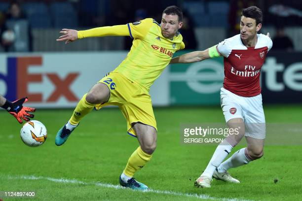 Borisov's Serbian forward Nemanja Milic and Arsenal's French defender Laurent Koscielny in action during the UEFA Europa League round of 32 first leg...