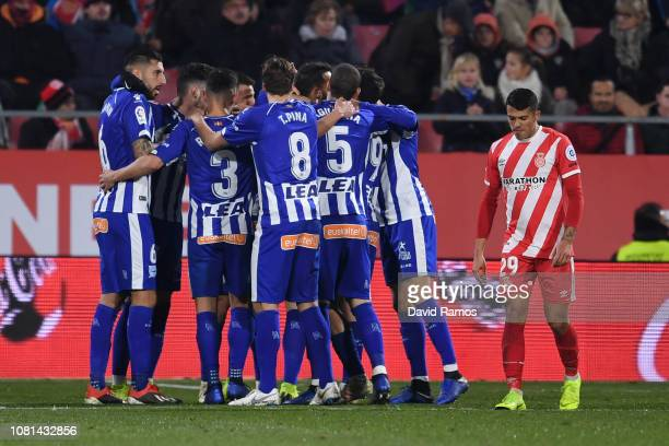 Borja Baston of Deportivo Alaves celebrates with teammates after scoring his team's first goal during the La Liga match between Girona FC and...