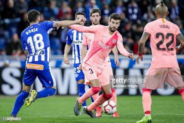 Borja Baston of Deportivo Alaves Gerard Pique of FC Barcelona during the La Liga Santander match between Deportivo Alaves v FC Barcelona at the...
