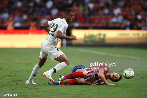 Borja Garces of Atletico Madrid goes to ground after tackled by Antoine Bernede of Paris Saint Germain during the International Champions Cup match...