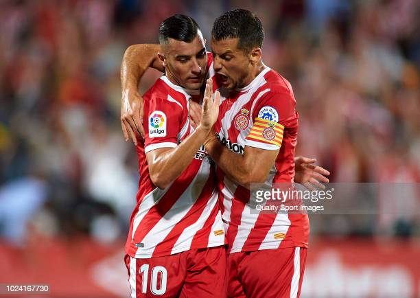 Borja Garcia of Girona celebrates after scoring his sides first goal with his teammates Alex Granell during the La Liga match between Girona FC and...