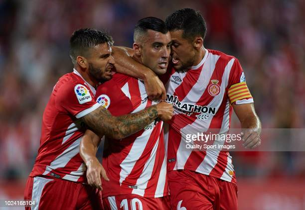 Borja Garcia of Girona celebrates after scoring his sides first goal with his teammates Alex Granell and Cristian Portugues during the La Liga match...