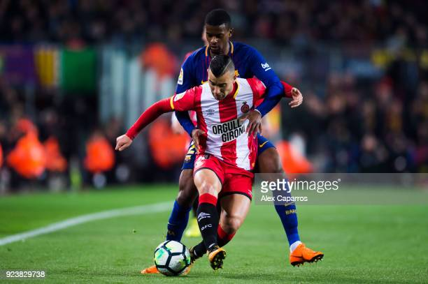 Borja Garcia of Girona FC and Nelson Semedo of FC Barcelona fight for the ball during the La Liga match between Barcelona and Girona at Camp Nou on...