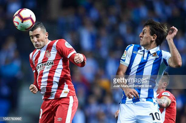 Borja Garcia of Girona FC competes for the ball with Mikel Oyarzabal of Real Sociedad during the La Liga match between Real Sociedad and Girona FC at...