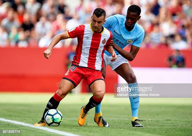 Borja Garcia of Girona is challenged by Tosin Adarabioyo of Manchester City during the preseason friendly match between Girona and Manchester City at...