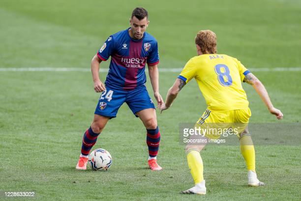 Borja Garcia of SD Huesca Alex of Cadiz CF during the La Liga Santander match between SD Huesca v Cadiz FC at the El Alcoraz Stadium on September 20...