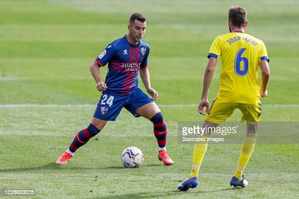 Borja Garcia of SD Huesca Jose Mari of Cadiz CF during the La Liga Santander match between SD Huesca v Cadiz FC at the El Alcoraz Stadium on...