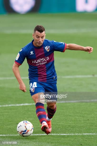 Borja Garcia of SD Huesca plays the ball during the La Liga Santander match between SD Huesca and Cadiz CF at Estadio El Alcoraz on September 20 2020...
