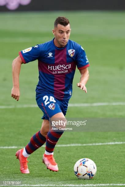 Borja Garcia of SD Huesca runs with the ball during the La Liga Santander match between SD Huesca and Cadiz CF at Estadio El Alcoraz on September 20...