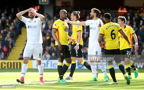 Borja Gonalez Baston of Swansea City and Fernando Llorente of Swansea City react during the Premier League match between Watford and Swansea City at...