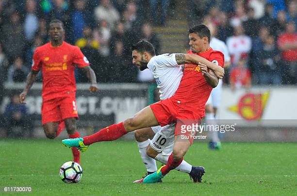 Borja Gonzalez of Swansea City and Dejan Lovren of Liverpool battle for possession during the Premier League match between Swansea City and Liverpool...