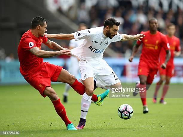 Borja Gonzalez of Swansea City is fouled by Dejan Lovren of Liverpool during the Premier League match between Swansea City and Liverpool at Liberty...