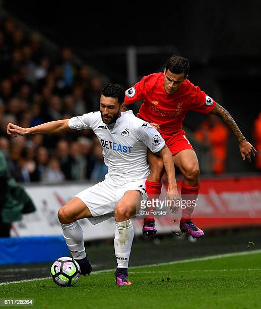 Borja Gonzalez of Swansea City is fouled by Philippe Coutinho of Liverpool during the Premier League match between Swansea City and Liverpool at...