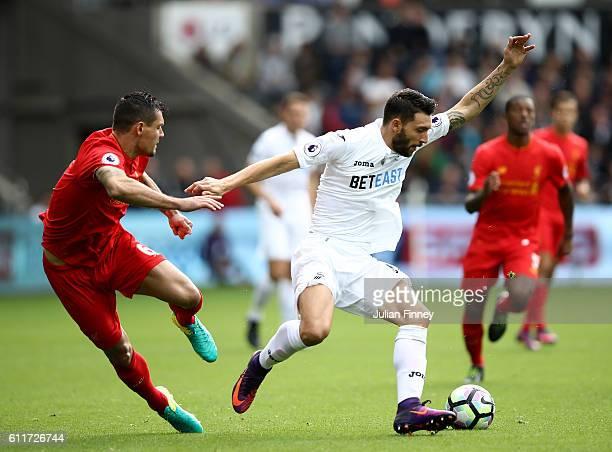 Borja Gonzalez of Swansea City is put under pressure from Dejan Lovren of Liverpool during the Premier League match between Swansea City and...